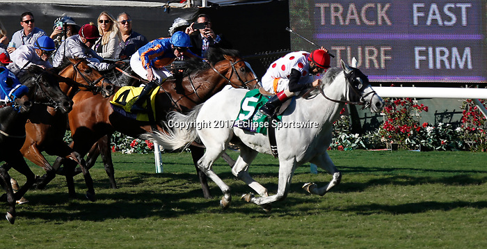 DEL MAR, CA - NOVEMBER 04: World Approval  #5, ridden by John Velazquez, wins the Breeders' Cup Mile  race on Day 2 of the 2017 Breeders' Cup World Championships at Del Mar Racing Club on November 4, 2017 in Del Mar, California. (Photo by Kazushi Ishida/Eclipse Sportswire/Breeders Cup)