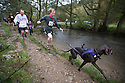 06/11/16<br /> <br /> ***WITH VIDEO***<br /> <br /> Despite temperatures barely rising above freezing around 1,400 crazy runners took on the cross-country challenge of a four-and-a-three-quarter mile run around the iconic Peak District beauty spot of the stepping stones at Dovedale.<br /> <br /> And it wasn&rsquo;t just human runners splashing through the River Dove, several hundred dogs had joined their owners to enjoy the 60th Dovedale Dash, an annual race which sees competitors tackle a circular loop to and from Thorpe. <br /> <br /> The popular race, which attracts many runners in fancy dress, was first run in 1953 but has missed some years due to flooded rivers and muddy pastures.<br /> <br /> All Rights Reserved F Stop Press Ltd. (0)1773 550665   www.fstoppress.com