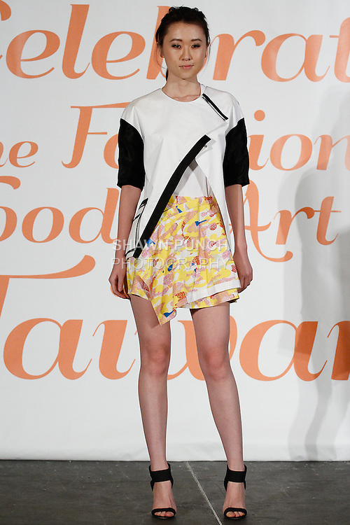 Model walks runway in an outfit from PRAXES, the Taiwanese fashion incubation program, during the Celebrate Taiwan @ Grand Central Terminal event on September 28, 103.
