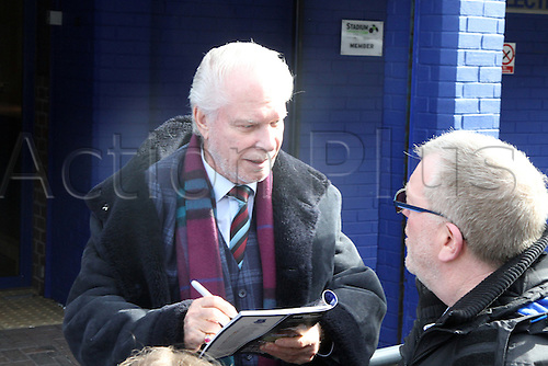 05.03.2016. Goodison Park, Liverpool, England. Barclays Premier League. Everton versus West Ham.West Ham chairman autographs the match programme for fans outside the stadium.