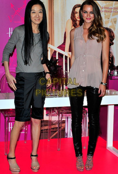 Vera Wang & Leighton Meester .The launch of 'Vera Wang Lovestruck' at Harrods London, England..June 9th, 2011.full length beige sleeveless top bottle black leather rubber sandals shorts grey gray ankle strap.CAP/CJ.©Chris Joseph/Capital Pictures.