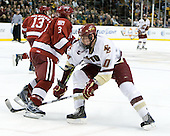 Alex Biega (Harvard - 3), Jimmy Hayes (BC - 10) - The Boston College Eagles defeated the Harvard University Crimson 6-0 on Monday, February 1, 2010, in the first round of the 2010 Beanpot at the TD Garden in Boston, Massachusetts.