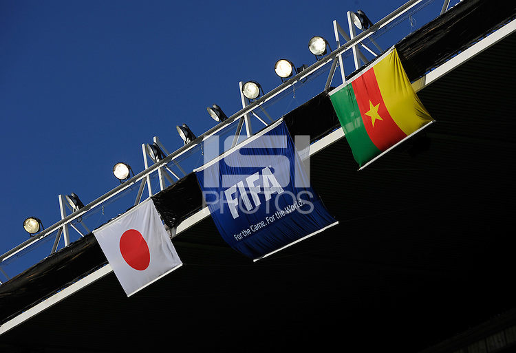 The Japan and Cameroon National flag alongside the FIFA flag, in the rafters of the Mangaung / Bloemfontein Stadium