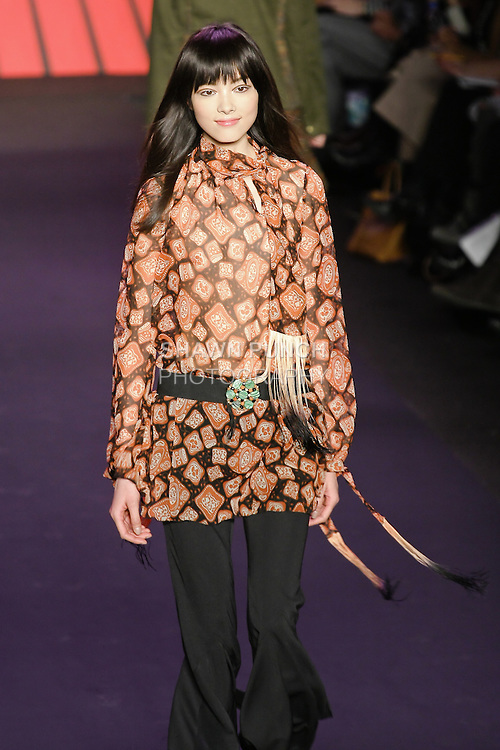 Fei Fei Sun walks runway in an outfit from the Anna Sui Fall 2011 collection, during Mercedes-Benz Fashion Week Fall 2011.