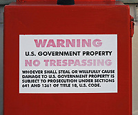 US Government Property warning on the visual approach slope indicator (VASI) light cover box at the Petaluma Municipal Airport, Petaluma, Sonoma County, California