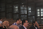 """Egyptian relatives attend a trial of Muslim Brotherhood members in a case known in media as """"Rabaa Operation Room"""", in Cairo on March 25, 2015. The prosecution accused the defendants of several charges relating to preparation of an operation room to guide the movement of the Muslim Brotherhood organization in order to confront the state and spread chaos in the country Rabaa and Al Nahda sit-in clearing, and also accused them of plotting to storm and burn police stations, private properties and churches. Photo by Amr Sayed"""