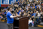 Matthew Charnay, coordinator for Jewish Student Services, leads students in a moment of reflection as they gather in McGrath-Phillips Arena Tuesday, Sept. 5, 2017, during a rally for New Student Service Day. Students fanned out across the city to volunteer at dozens of community organizations following the early morning rally on the Lincoln Park Campus. (DePaul University/Jamie Moncrief)