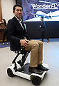 "March 9 2017, Tokyo, Japan - Yosuke Takahashi, executive of Takahashi Seigawara demonstrates the prototype model of a foldable electric wheelchair ""Scoo"" which enables to carry into the plane at a presentation of All Nippon Airways (ANA) crowdfunding ""WonderFLY"" in Tokyo on Thursday, March 9, 2017. The unique electric wheelchair is developed with Daido University professor Takashi Ifuji.    (Photo by Yoshio Tsunoda/AFLO) LwX -ytd-"