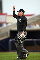 Umpire Jordan Johnson during the first game of a doubleheader between the Wisconsin Timber Rattlers and Quad Cities River Bandits on August 19, 2015 at Modern Woodmen Park in Davenport, Iowa.  Quad Cities defeated Wisconsin 3-2.  (Mike Janes/Four Seam Images)