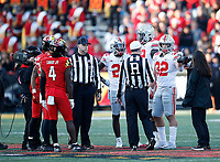 Ohio State Buckeyes and Maryland Terrapins players stand at a coin toss going into overtime during their game at Maryland Stadium in College Park, MD on November 17, 2018. [ Brooke LaValley / Dispatch ]