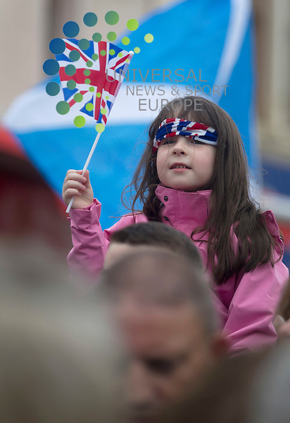 Children wait on the street corner before the Olympic flame comes through the streets of  Stewarton. Scotland has welcomed the Olympic torch for the first time as the relay travels from  to Glasgow on day 21.Picture: Maurice McDonald/Universal News And Sport (Europe). 8 June 2012. www.unpixs.com.
