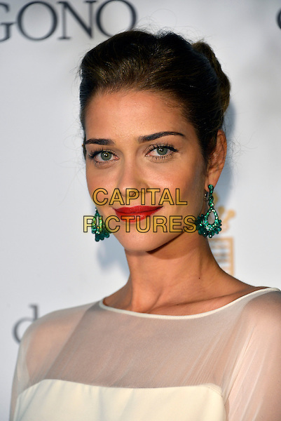 Ana Beatriz Barros. 'De Grisogono' party arrivals at the Eden Roc, Hotel du Cap, Antibes during the 66th  Cannes Film Festival, France 21st May 2013.headshot portrait white red lipstick sheer dangling green earrings .CAP/PL.©Phil Loftus/Capital Pictures.