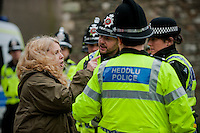 Saturday 05 April 2014<br /> Pictured: A woman shouts at white pride supporters over the police line<br /> Re: White Pride and Anti Fascist groups protest in Swansea City Cebtre