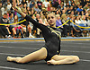 Jacklyn Dolitsky of Commack performs her floor routine during the Suffolk County varsity girls' gymnastics individual championships at Babylon High School on Friday, November 6, 2015.<br /> <br /> James Escher