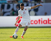 CHARLOTTE, NC - JUNE 23: Jonathan Osorio #21 passes the ball during a game between Cuba and Canada at Bank of America Stadium on June 23, 2019 in Charlotte, North Carolina.