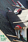 Pro seen putting the shingles on a very steep roof.