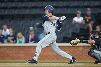 Cole Austin (28) of the West Virginia Mountaineers follows through on his swing against the Wake Forest Demon Deacons in Game Six of the Winston-Salem Regional in the 2017 College World Series at David F. Couch Ballpark on June 4, 2017 in Winston-Salem, North Carolina. The Demon Deacons defeated the Mountaineers 12-8. (Brian Westerholt/Four Seam Images)