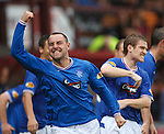 Kris Boyd is mobbed after scoring to win the game for Rangers