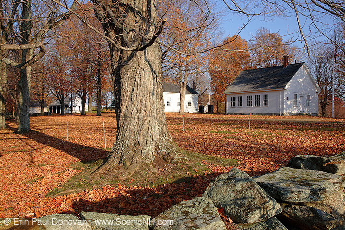 Smith Meetinghouse School (right) in Gilmanton, New Hampshire USA during the autumn months. This schoolhouse is located next to the Smith Meetinghouse.