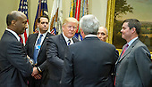 """United States President Donald Trump greets representatives from PhRMA, the Pharmaceutical Research and Manufacturers of America in the in the Roosevelt Room of the White House in Washington, DC on Tuesday, January 31, 2017.  According to its website PhRMA """"represents the country's leading biopharmaceutical researchers and biotechnology companies."""" <br /> Credit: Ron Sachs / Pool via CNP"""