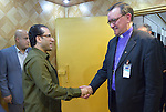 Iraq's Deputy Interior Minister Aqeel al-Khazali (left) greets Bishop Martin Hermann Hein of the Evangelical Church in Germany during the visit of an ecumenical delegation to al-Khazali's office in Baghdad on January 21, 2017.