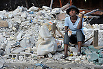 A woman sells bottled drinks in the devastated center of Port-au-Prince, Haiti, which was ravaged by a January 12 earthquake.