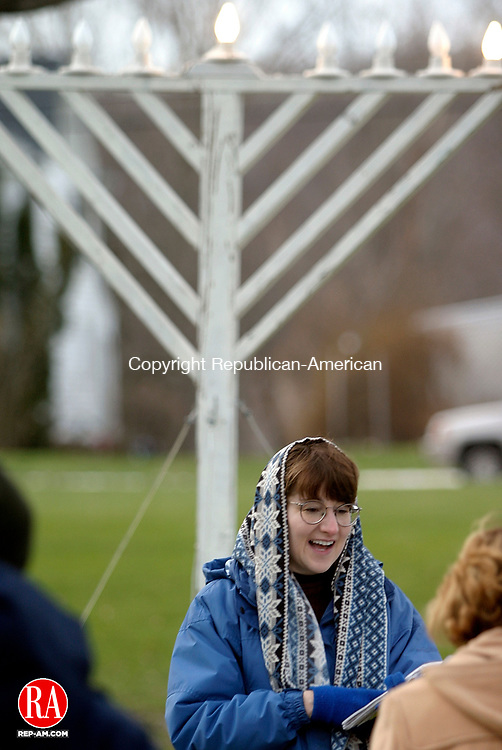 MIDDLEBURY, CT 12/19/03 1219TM05.03 Several Jewish residents of Middlebury gathered on the town green to see the lighting of a ceremonial Menorah, as well as to sing religious songs and say blessings, in celebration of the first day of Chanukkah. One more light will be lit on the Menorah for every passing day of Chanukkah. Pictured is Rachel Bashevkin (wearing a prayer shawl), who was leading the ceremonyToby Morris photo