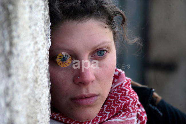 A foreign protester attends a demonstration against the expropriation of Palestinian land by Israel in the village of Kfar Qaddum, near the occupied West Bank city of Nablus, on January 18, 2013. Photo by Nedal Eshtayah