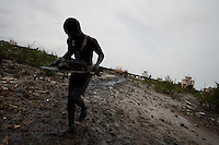 Casimiro 17 years old, collects metal scraps to be sold for a few pennies from the mud around the port of Bissau, Guinea Bissau on Monday Sept 17 2007.///..Guinea Bissau is infamous for its cocaine trafficking. in 2005 Colombian cartels begun to arrive in the country transforming it into a Narco State. Up to 5 tons of pure cocaine are estimated to be arriving in the country every week. Guinea Bissau is the 5th poorest country in the world, making it the ideal transit base for the cocaine that will finish on the european markets. Corruption and involvement in the trafficking are present at every level of its institutions..Guinea Bissau is only one of the countries in West Africa involved in cocaine trafficking. Tons of Cocaine have been seized in Nigeria, Senegal, Ghana and  Sierra Leone.