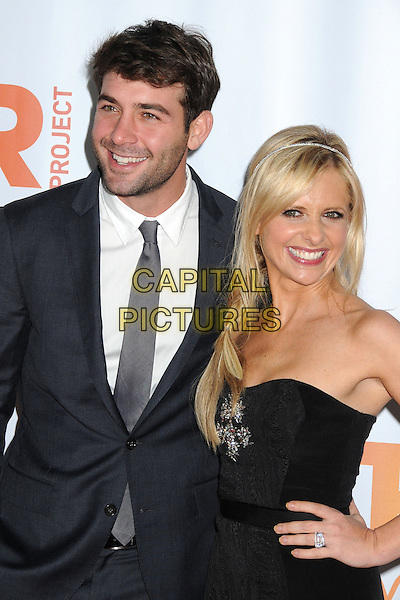 HOLLYWOOD, CA - DECEMBER 08: James Wolk, Sarah Michelle Gellar at the TrevorLIVE Los Angeles Benefit celebrating The Trevor Project's 15th anniversary at the Hollywood Palladium on December 8, 2013 in Hollywood, California.<br /> CAP/ADM/BP<br /> &copy;Byron Purvis/AdMedia/Capital Pictures