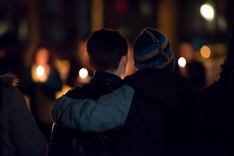 Ohio University students Dani Knowles (left) and Caitlin Phillips (right) embrace as names of victimized students are read at the Transgender Day of Remembrance candle light service on November 20th, 2013. Knowles and Phillps have been dating for 9 months. Photo by Royle Mast.