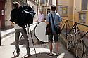 Yan Morvan (centre), photographer, poses along a street in Arles, July 8, 2016. His exhibition, Battlefields, is at Les Rencontres de la Photographie in Arles. &copy; Carlo Cerchioli<br /> <br /> Yan Morvan, fotografo, posa lunga una strada di Arles, 8 luglio 2016. La sua mostra Battlefields &egrave; ai Les Rencontres de la Photographie di Arles.