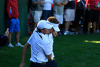Rory McIlroy and Ian Poulter watch on, on the 14th hole during the Sunday singles matches of the 39th Ryder Cup at Medinah Country Club, Chicago, Illinois .(Photo Colum Watts/www.golffile.ie)