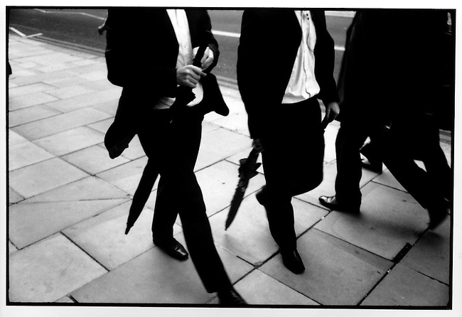 Businessmen leave offices in the capital's business district. City of London, London, July 7, 2005