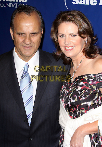 JOE TORRE & ALI TORRE .6th Annual Joe Torre Safe At Home Foundation Gala honoring the 1998 World Series Champion New York Yankees held at Chelsea Piers, New York, NY, USA..November 7th, 2008.half length black suit jacket white purple .CAP/ADM/PZ.©Paul Zimmerman/AdMedia/Capital Pictures.