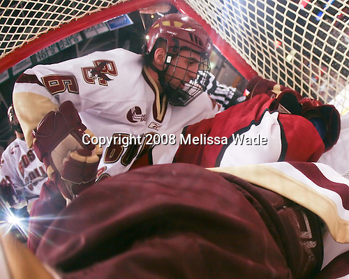 Tim Kunes (BC 6) and Matt McCollem (Harvard 23) join John Muse (BC 1) in the net. The Boston College Eagles defeated the Harvard University Crimson 6-5 in overtime on Monday, February 11, 2008, to win the 2008 Beanpot at the TD Banknorth Garden in Boston, Massachusetts.
