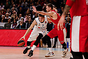 9th February 2018, Wiznik Centre, Madrid, Spain; Euroleague Basketball, Real Madrid versus Olympiacos Piraeus; Luka Doncic (Real Madrid Baloncesto) brings the ball foward against Evangelos Mantzaris (OLYMPIACOS BC)