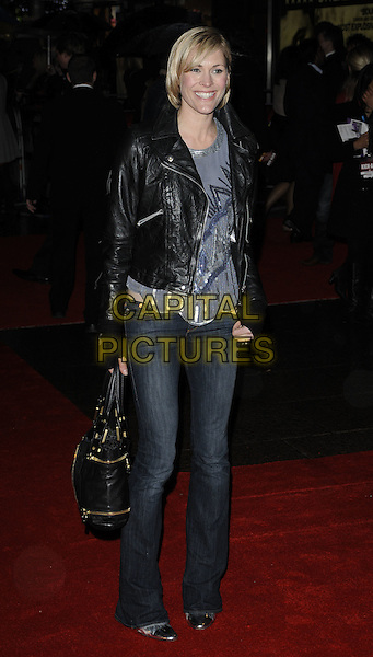 JENNI FALCONER.'Kick-Ass' UK film premiere, Empire cinema, Leicester Square, London, England, UK..March 22nd, 2010.arrivals full length black leather biker jacket grey gray silver top jeans bag sequined sequin shoes shiny.CAP/CAN.©Can Nguyen/Capital Pictures.