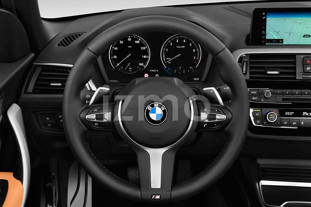 Car pictures of steering wheel view of a 2018 BMW 2 Series M-Sport 2 Door Convertible