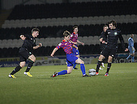Lewis McLear (centre) tackles Bahrudin Atajic as Lewis Kidd watches in the St Mirren v Celtic Clydesdale Bank Scottish Premier League U20 match played at St Mirren Park, Paisley on 18.12.12.