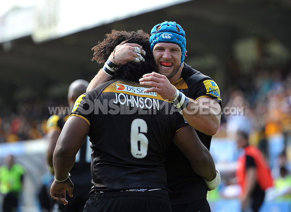 James Haskell congratulates Ashley Johnson on his try for Wasps. European Champions Cup play-off, between London Wasps and Stade Francais on May 18, 2014 at Adams Park in High Wycombe, England. Photo by: Patrick Khachfe / JMP