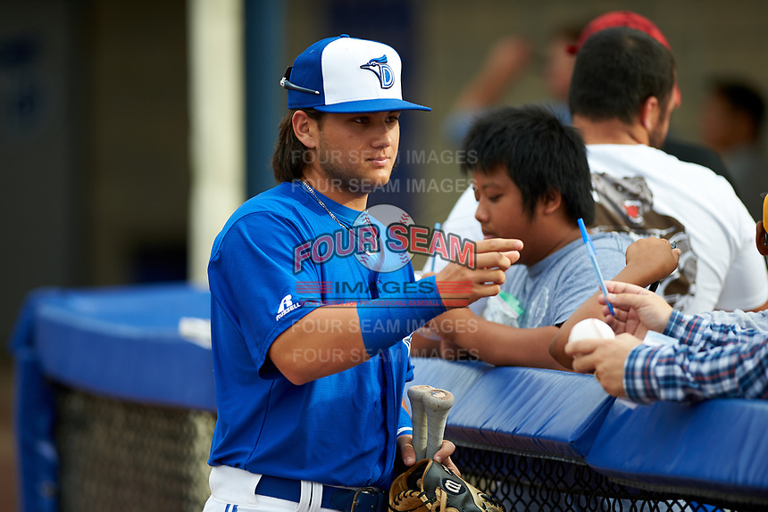 Dunedin Blue Jays designated hitter Bo Bichette (10) signs autographs for fans before a game against the Bradenton Marauders on July 17, 2017 at Florida Auto Exchange Stadium in Dunedin, Florida.  Bradenton defeated Dunedin 7-5.  (Mike Janes/Four Seam Images)