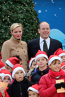Princess Charlene of Monaco and Prince Albert II of Monaco attend the Christmas Celebration - Monaco