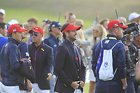 Jordan Spieth, Justin Thomas and Bubba Watson (Team USA) on the 18th green during the Sunday Singles of the Ryder Cup, Le Golf National, Ile-de-France, France. 30/09/2018.<br /> Picture Thos Caffrey / Golffile.ie<br /> <br /> All photo usage must carry mandatory copyright credit (© Golffile | Thos Caffrey)