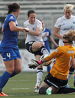 Boston Breakers substitute goalkeeper Alyssa Naeher (1) stuffs Seattle Reign FC forward Elizabeth Bogus (5) shot. In a National Women's Soccer League (NWSL) match, Seattle Reign FC (white) defeated Boston Breakers (blue), 2-1, at Dilboy Stadium on June 26, 2013.