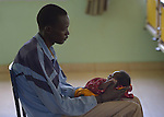 Jameis Dual holds his 12-day old daughter Aden, who is suffering from malaria, in the St. Daniel Comboni Catholic Hospital in Wau, South Sudan.