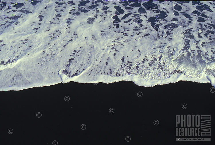 wave breaking on a black sand beach, Big Island of Hawaii