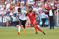 Commerce City, CO - Thursday June 08, 2017: Sheldon Bateau and Jozy Altidore battle during their 2018 FIFA World Cup Qualifying Final Round match versus Trinidad & Tobago at Dick's Sporting Goods Park.