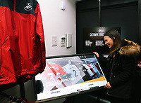 Lucy Norman at the new interactive screen in the Swansea City FC shop opening in Union Street, Swansea, Wales, UK. Saturday 07 October 2017