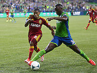 Jhon Kennedy Hurtado, left, of the Seattle Sounders FC battles Joao Plata of Real Salt Lake during play at CenturyLink Field in Seattle Friday September 13, 2013. The Sounders won the match 2-0.